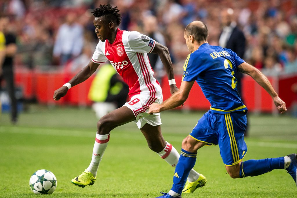 AMSTERDAM - 16-08-2016 , Ajax - FK Rostov , Voetbal , Amsterdam Arena , Seizoen 2016/2017 , Champions League voorronde , Ajax speler Bertrand Traore (l) FK Rostov speler Timofei Kalachev (r)